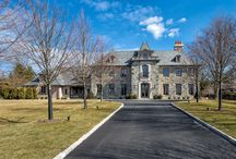 Greenwich Normandy / An elegant French Normandy style home with ocean views articulated in granite, limestone, hand-hewn timbers, and reclaimed brick.