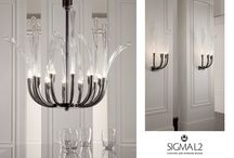Curves of glass / The new chandelier experiments the curves of glass along with the constant search for innovation to design a new classic. Design Simone Granchi 2011 www.sigmal2.it