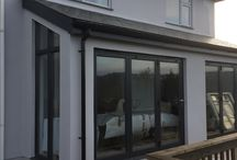 St Mawgan - SIPS Extension & Garden Box / A SIPS extension in St Mawgan was completed by BWF to a full turnkey finish.  Aluminium sliding doors offer fantastic views and access onto the decked balcony and light floods into the existing building.  The clients were delighted with the work carried out and commissioned BWF to supply a Garden Box as well set down below the balcony.