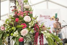 Vintage Floral displays at festival wedding / Vintage flowers at Festival wedding. For more information please contact www.weddingfestivalcompany.co.uk
