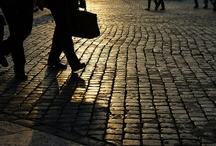 """Sanpietrini / Sanpietrini (also Sampietrini) is the typical kind of pavement found in the city centre of Rome. It is made of bevelled stones of black basalt (""""sampietrini""""), placed one next to the other. It was invented under Pope Sixtus V and was used to pave all the main streets of Rome, because it was superior to other forms of paving in terms of the transit of carriages."""