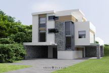 Dom w Gdyni / Projekt domu położonego w pięknym otoczeniu Gdyńskiego Pogórza. Na uwagę zasługują nowoczesna bryła budynku z płaskimi dachami oraz elewacja z naturalnego kamienia uzupełnionego drewnem. Ciekawe ukształtowanie terenu umożliwiło zaprojektowanie przy domu aż trzech tarasów.