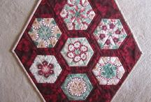 """Kaleidoscope Quilts by the Quiltsy Team on Etsy / Beautiful Quilts with a Kaleidoscope effect obtained by using the """"Stack and Whack"""" or """"One Block Wonder"""" technique"""