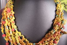 Fiber and Ribbon Jewelry / Necklaces, bracelets and earrings that are made or embellished with fibers. Linen, cotton, leather, wool, silk and more.