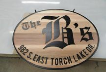 Hand Carved Signs / Taking sign making old school. A combination of hand carved, hand routed and machine routed signs.
