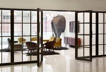 Mother London office interior design / We have created a refectory and events space that can take the daily abuse of a hungry agency. Meeting rooms with built in elephants. A bespoke Formica clad studio table the length of a swimming pool. Team tables for the creatives that involved a 30 tonne concrete pour through a second floor window.