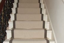 Carpet On Stairs / Client – Private Residence in Central London 100% wool loop pile heavy domestic carpet laid to stairs with taped edges and brass stair rods. Jatoba Lacquered Engineered Boards installed to entire Ground Floor with undercut skirtings to allow for expansion