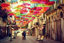 Águeda: Umbrella Festival / Have you ever seen thousands of coloured umbrellas suspended above a city street? No? Then make sure you visit the Umbrella Festival in the Portuguese city of Agueda, because each and every year during July this is exactly what happens! Enjoy the shade they create as you walk along the promenade.