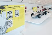 Cars&Comics / 2013 Exhibition at Museo Enzo Ferrari in Modena. Graphic design of exhibition and catalogue by negrini+varetto. Texts and coordination by Claudio Varetto.