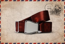 Brown Uluru - Fly-Belts aicraft seat belts redesigned as fashion accessories / Designed by and for international travelers, Fly-Belts are adapted airplane seat belts recast to fit all types of pants and jeans. Express & share your frequent flyer experience with this original travelwear.  - Color : Brown Uluru - One way pack : 1 buckle + 1 belt - 2 available sizes for buckle thickness and belt's webbing width - Original (48mm) and Slim (38mm) - One length fits all - Airline resistant webbing. Aluminium buckle