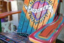 yard art, plants,bird houses ect. / painted chair / by Melody Hampshire