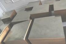 B_Squared Bookcase / La Libreria B_Square Bookcase è assemblata con un sistema a incastri, senza viti, chiodi o colla, in legno di castagno, con una lavorazione in biglia.  18 moduli, una nuvola di elementi, sfaccettata e cangiante come il dorso di un pesce, grazie alla finitura in rame nichelato e spazzolato delle ante.