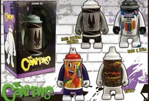 The Canmans / The Canmans are a series of vinyl figures focused on graffiti artists and the art of collecting spray paint cans. There are 2 editions of the Canmans, the Artist Editions and the Blank Editions. The Artist Edition are limited edition Canmans that have been designed by some of the world's most prolific graffiti artists. Each artists creates the artwork and design for their exclusive Canman figures.