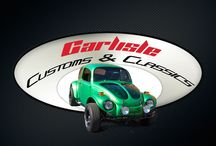 1970 VW Baja Bug / This is a beautifully customized 1970 VW Baja Beetle.  It features a Baja fenders, front and rear bumper support bars, black racing seats, custom bright green paint with black marbleized racing stripes.