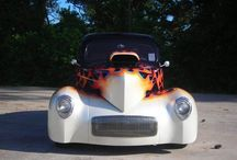 """1941 Willys Americar Pro Street For Sale / $82,800.00  ProStreet Outlaw Performance body & chassis, Currie 9"""" s/s 4 link,wilwood disc, polished alum. calipers, Colorado Custom wheels 18.50 Hossiers on rear. Chevrolet Ram Jet 502c.i. hyd roller, oval port alum heads, custom built Hughes TH400 trans, B&M Mega shifter /line lock, custom leather interior, A/C, door popper, elec trunk open, polished NOS bottle,PPG Black & pearl white diamond, House of colors custom FLAMES. A real custom classic show winner and cruiser!"""