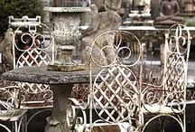 Garden Dreams / We love all things gardens, from bird houses to antique concrete planters. The well designed garden finishes the home and delights the heart!