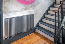 Bisque Finn Radiator / We find this radiator is a popular choice with architects and designers, who like its clean lines and crisp elegance. Because its elements reflect the vertical lines of the room, it can complement a range of interior styles and is therefore one of most versatile radiator designs. Plus it's available in over 800 bespoke sizes.