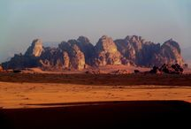Wadi Rum Desert / If you love Adventure - The you will love Wadi Rum. Here you can hire a Camel and follow in the footsteps of Lawrence of Arabia, climb the highest peaks, or take a 4x4 jeep tour across the rolling sands. Go hiking and explore the hidden canyons with stone carvings from over 4000 yrs ago.