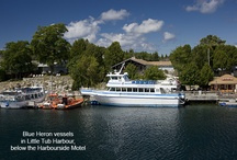 Tobermory / The beautiful Town of Tobermory Ontario.  A small fishing villiage which has grown into a popular tourist destination. Crystal clear waters and rugged shorelines can be found within our Two National Parks - Bruce Peninsula National Park and Fathom Five National Marine Park.