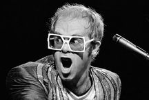 Celebrity Eyewear: Elton John Eyewear / Sir Elton Hercules John CBE (born Reginald Kenneth Dwight on 25 March 1947) is an English singer-songwriter, composer, pianist, record producer, and occasional actor. He has worked with lyricist Bernie Taupin as his songwriter partner since 1967; they have collaborated on more than 30 albums to date.