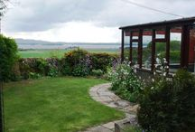 Gate Lodge Self Catering / Gate Lodge – the cottage with the amazing view   A big welcome to all guests, new and returning! The Lodge is a cosy, cheery cottage with sunroom, pretty garden and a spectacular view.