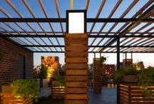 West Village Co-Op / With a unique 360-degree view of the city from this West Village Co-Op building, the existing decaying deck had been falling short of the roof's potential. CDL/S' redesign for the rooftop maximizes the view, while at the same time dividing new spaces between scattered mushroom vents and exhaust pipes. These spaces range from intimate corners to large, open flex areas, which allows for a wide variety of uses by the residents.