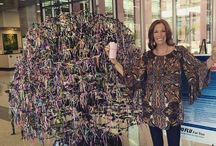 """Breast Cancer Awareness / Some of you may know, but our founder, Lauri Leadley, was recently diagnosed with breast cancer. Here she is with The Tree of Hope representing all of the different cancer patients. She says, """"You each are my hope. I am so grateful for your love and prayers."""" As a cancer survivor for over 23 years, this is nothing new to Lauri. She is our inspiration."""