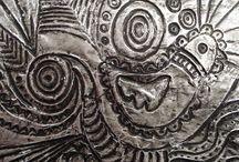 reliéf kovová fólie
