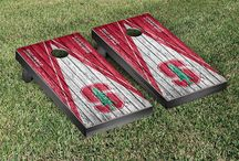 "Pac-12 Gamedays | Victory Tailgate / Our officially licensed collegiate cornhole games are made proudly in the USA. Each game set comes with two 24""x48"" regulation boards with folding legs, a complete bag set (8 bags), and a FREE string pack to carry the bags (A $10 value!)"