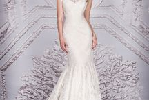 Suzanne Neville / Suzanne Neville is one of Europe's leading designers of bridal and evening wear. Most well known for beautifully constructed wedding gowns and glamorous evening dresses with signature-structured bodices, the collection is incredibly diverse.  Available at our Birmingham store.