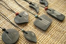 Bamboo Charcoal Pendants / Crafted by Michihiro, founder of the Charcoal People, these unique pendants are as good to touch as they are to look at.  Solid yet light, they have a surface so pleasingly smooth that you'll want to touch them all the time.