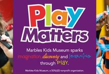 Marbles Kids Museum / Why Marbles? A wall that wraps around the museum is filled with more than one million marbles that light up at night. And Marbles is a nickname for brains.