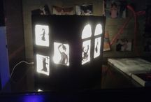 The Scary House night lamp. / I made this Scary House night lamp from a cardboard box lying around the house. covered it with chart paper, used butter paper for the windows and door, painted silhouettes onto them with black acrylic paint, and lastly, lined it with fairy lights inside.