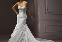Clearance Gowns / Store sample gowns that have been discontinued. Beautiful styles at great prices!