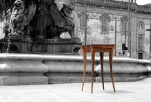 Elegance | Console / The Lions Square always had an elitist character, with a very  The 'Elegance' console is based on the fountain, in its movement and shape. It is quite slim, elegant and with an aspect of superiority, typical of the elitist Lions Square. Made in palisander wood and satin wood on the inside, with the movement of water that gets out from the lions mouth at its base of support and the secrecy typical of the elite represented in a secret drawer in which its interior form accompanies the exterior.
