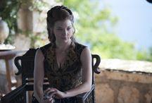 Margaery wears a rose-printed dress