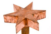 Steel Screens, Sheep & Copper Stars / We can laser cut sheet steel into sheep, ponies, gardeners, dogs,- whatever - to add a note of cheerfulness  to your garden. The mild steel will quickly develop a rich rusted patina.   The sheep silhouettes are cut from 5mm thick solid steel and weigh 12kg, 10kg and 4kg respectively. Integral spikes simply push into the ground