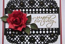 Red rose on black die birthday card