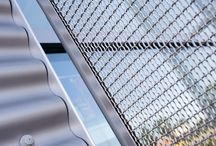 Decorative Panels / Powder-coated aluminium or pre-finished stainless steel formed panels can be produced with bespoke perforation patterns for a striking architectural statement with superior screening performance.