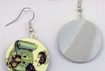 """House-Mouse Jewelry / Our new line of earrings are created in the studio of clay artist Nancy Revoir Dezotell. Each earring is hand made by Nancy in a multi step process working with polymer clay and are finished by using silver hypo-allergenic findings. The back side has the look of marble. They arrive nicely packaged in individual gift boxes ready to bring a smile to the lucky recipient. Each earring measures approx. 7/8"""" diameter"""