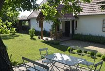 Káli Cottages at Lake Balaton / Set in the rolling hills of the Balaton Uplands between Köveskál and Révfülöp, Káli Cottages are situated in a small village called Kővágóörs at the heart of the Kál Basin. The charming 3-bedroom/2-bathroom cottages include a private garden, a spacious outdoor kitchen making it an ideal home base for the perfect countryside holiday.
