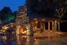 Rustic Outdoor Living Space / The McKay team traveled to South Dakota to install outdoor lighting. The homeowners created an old rustic feel using distressed wood, natural stone, stained concrete, and burnt steel panels.  Landscape lighting sets the mood at night and allows guests to safely move around the space with all the various different home levels and materials used. / by McKay Landscape Lighting