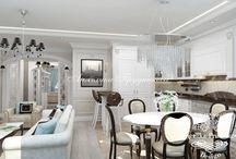 Интерьер квартиры в стиле неоклассика в ЖК Английский квартал / Интерьер квартиры в ЖК «Английский квартал» притягивает статностью стиля неоклассика.  Гостиная комната открытого типа совмещена с кухней и столовой, благодаря этому значительно увеличивается пространство. Белый и коричневый цвет вносят свой приятный контраст, и создаёт индивидуальный дизайн комнат.