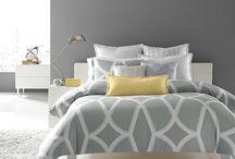 Dormitorios griss y amarills