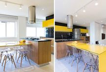 Apartment with kitchen that explores the contrast of yellow and black