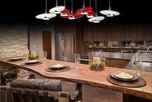 Virtuvė | Apšvietimo idėjos / Virtuvės apšvietimas. Kiekvienai virtuvės zonai galima rinktis skirtingo šviesos intensyvumo ir dizaino šviestuvus, bei skirtingas valdymo galimybes. Bendram virtuvės apšvietimui puikiai tiks LED šviesos panelės ar lubiniai šviestuvai, kurie tolygiai apšvies visą virtuvę, darbo zonai galima rinktis LED juostą po kabančia spintele pagrindo apšvietimui ar į baldus integruotus šviestuvus. Valgomajam virš stalo tinka įvairūs, išskirtinio dizaino LED pakabinami virtuvės šviestuvai. www.elmo.lt