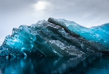 """Rare Imagery of Flipped Icebergs in Antarctica / While on an expedition in Antarctica, photographer Alex Cornell had the rare opportunity to photograph a recently flipped iceberg. Defining to the old adage """"just the tip of the iceberg,"""" it turns out the underside can be illuminated with unbelievable bright blues and striation that reveal visually stunning secrets of these sleeping giants. 
