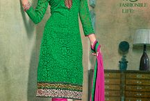 Salwar suits - Cotton Brasso / Straight cut suit on cotton brasso fabric this suit has resham thread floral embroidery work over the border with lace border work, this suit can be stitched up to size 44.