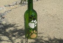 Great gift for dog lovers / Hand made wind chimes from recycled wine bottles. Painted multi size, and colored dog paws. They all sound great