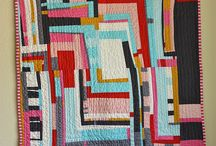 Elements of Modern Quilting / Inspired by modern design, Modern quilts usually contain certain elements which may include: Negative Space, Bright Colors, Improvisational Piecing, Asymmetry, Grid Work and Exaggerated Scale.